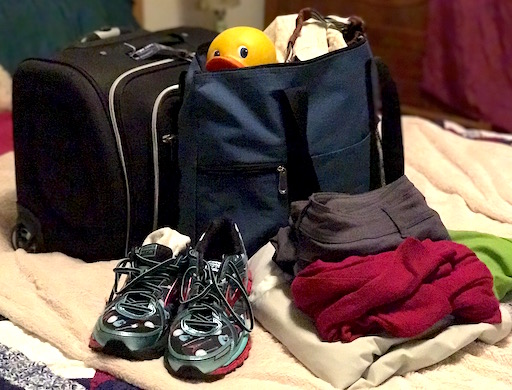Pack it up! Rolling carry-on, tote bag, running shoes and outfit to wear on the plane.